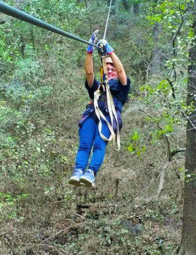a woman ziplining