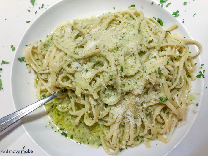 A pasta dish with pesto on a plate