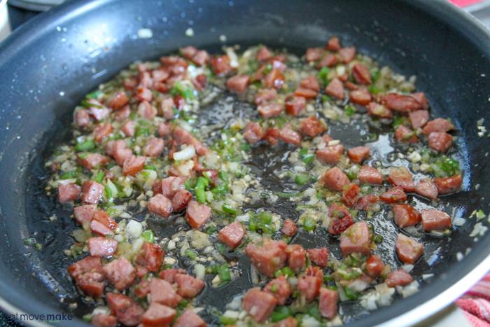 saute kielbasa, onions, garlic and jalapeno