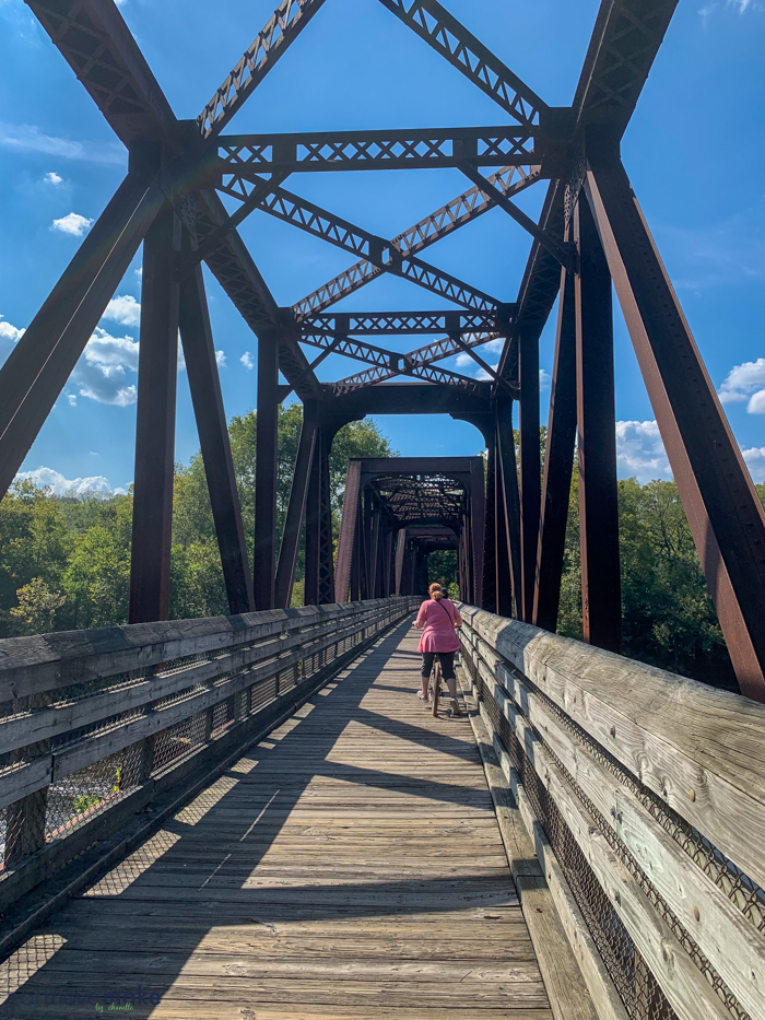 A bike traveling over a bridge