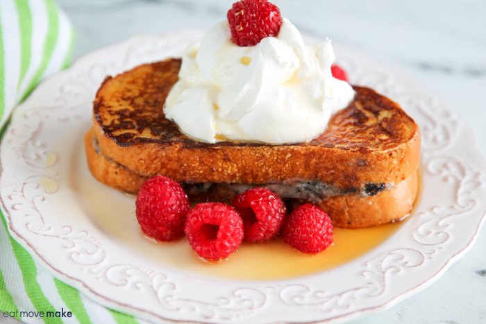stuffed oreo french toast on plate with syrup and raspberries