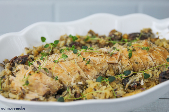 slow cooker turkey tenderloin in serving dish with herbs on top