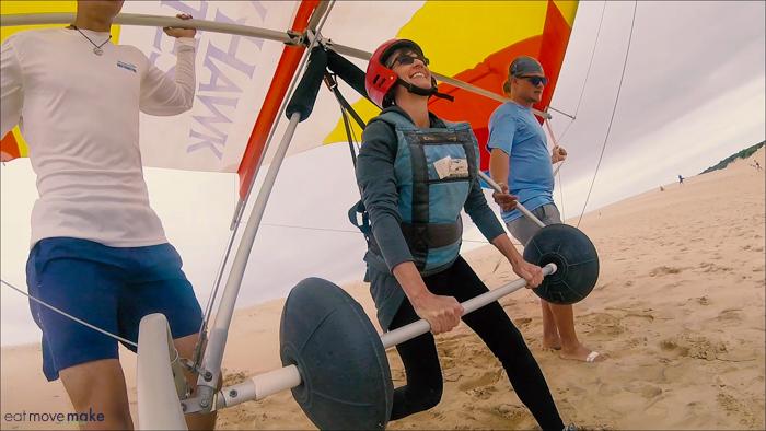 dinosaur stance for hang gliding in dunes