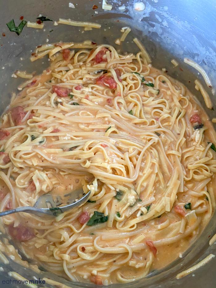 stirring pasta in bowl