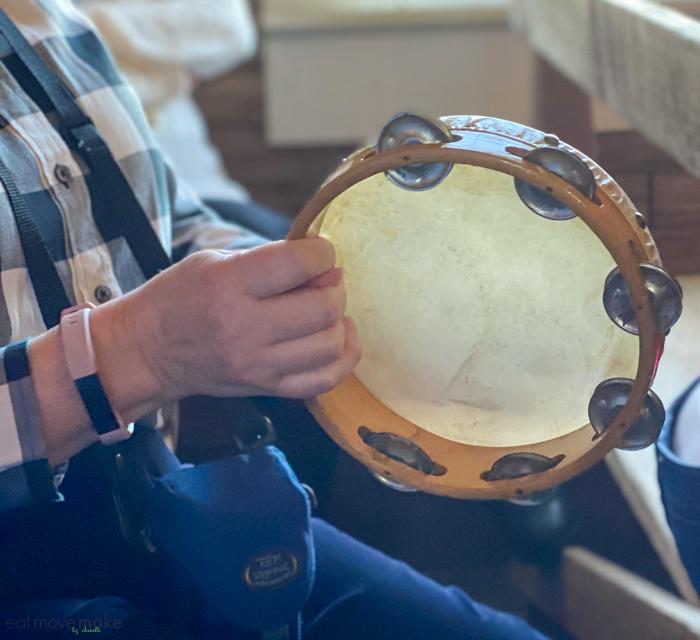 playing tambourine at Frogmore Plantation