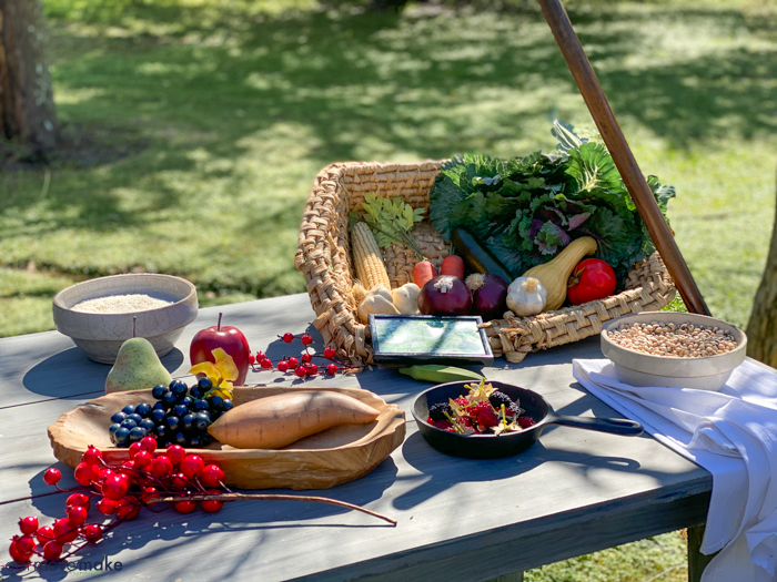 A plate of typical plantation food on picnic table