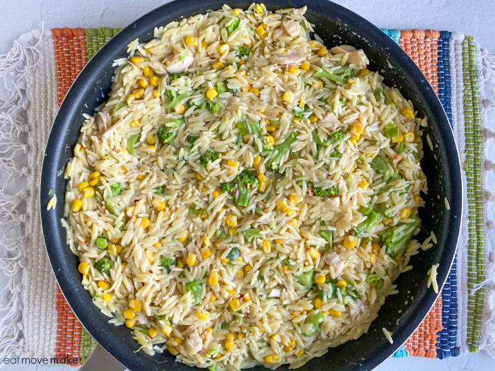 chicken orzo casserole in skillet on table