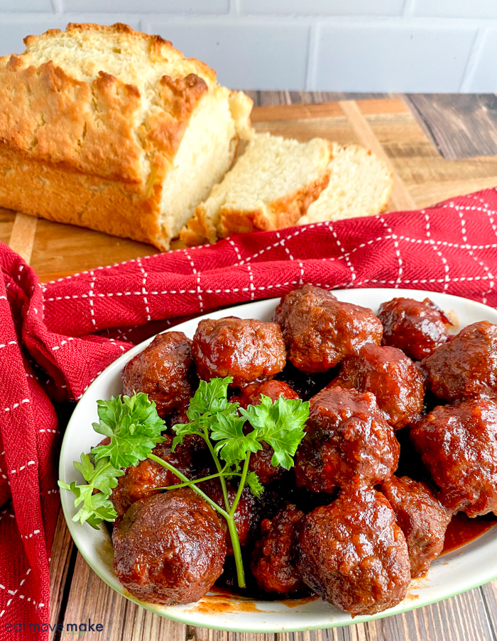 A tray of meatballs and loaf of bread