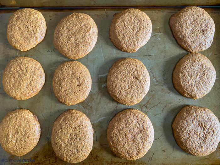 fresh baked ginger cookies on cookie sheet
