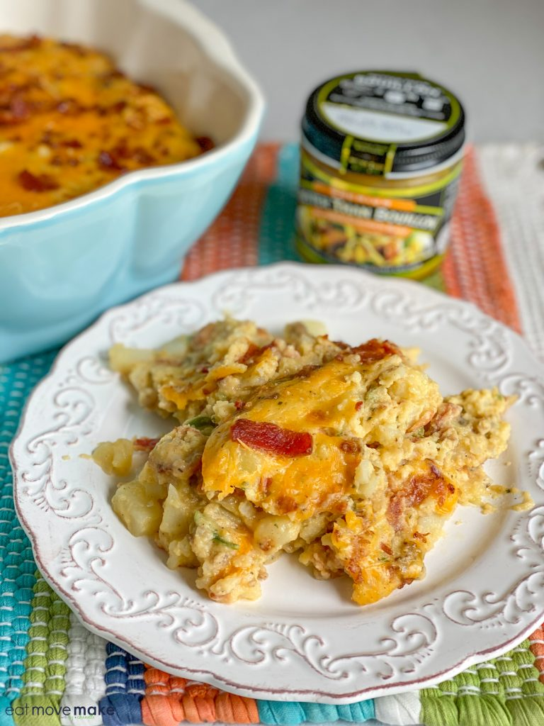 loaded breakfast casserole on plate with Better than Bouillon in background