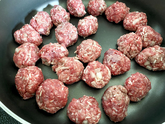 cooking meatballs in skillet