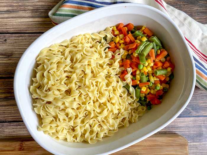 noodles and mixed vegetables in casserole dish