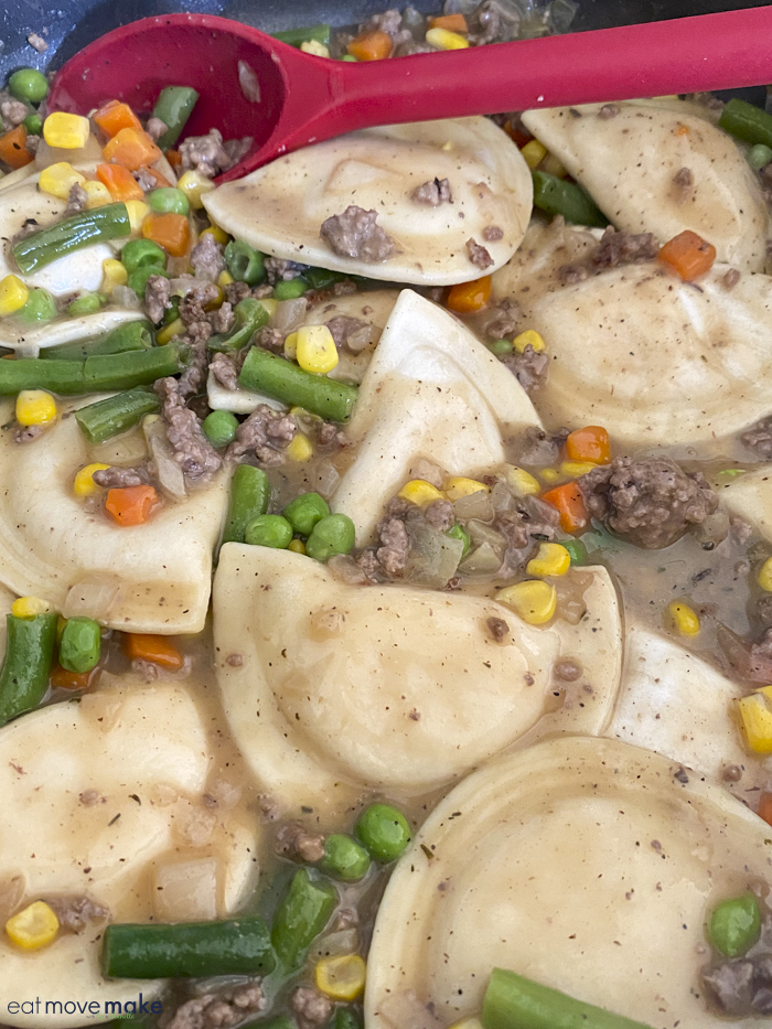 pierogies cooking in skillet