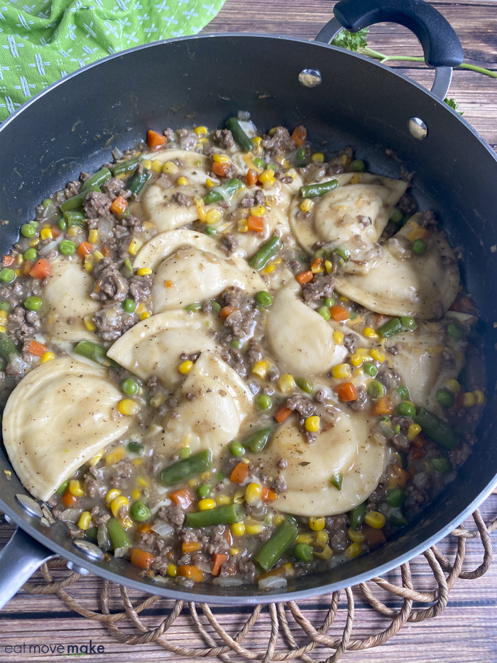 pierogies in skillet with gravy