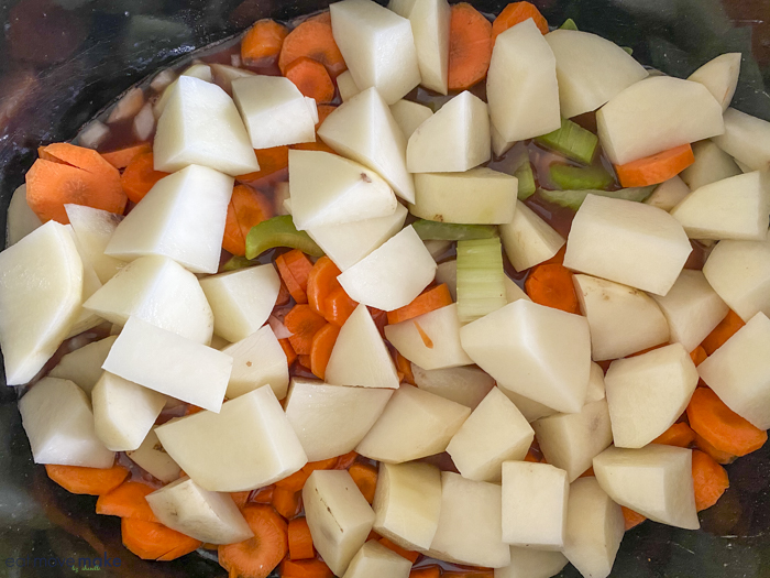 potatoes, celery and carrots in crockpot for stew