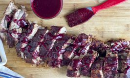add extra sauce to baked ribs on cutting board