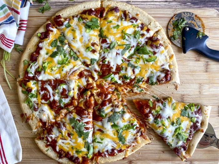 chili pizza slice and pizza cutter