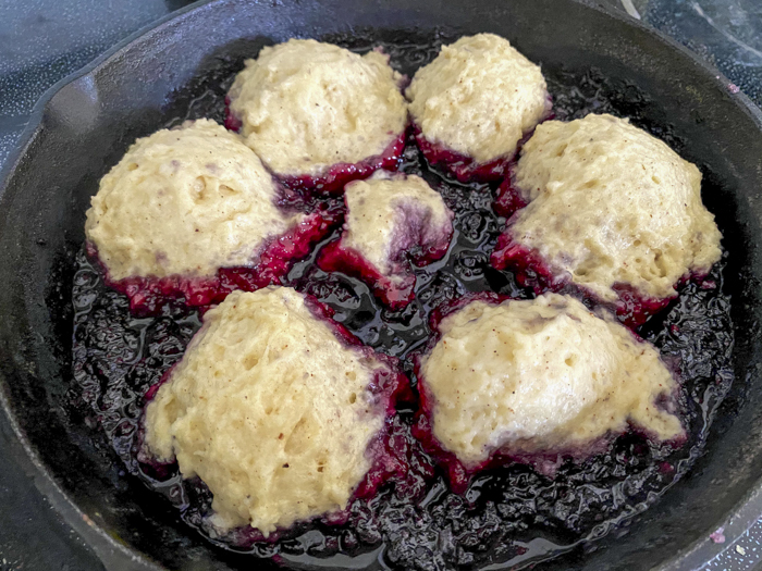 dumplings on hot blackberry sauce