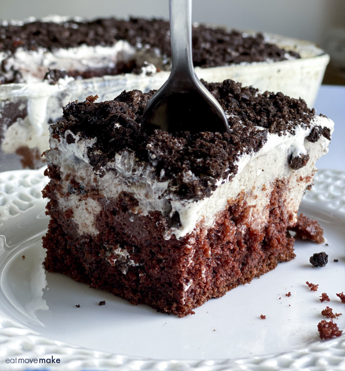 oreo poke cake on plate with fork