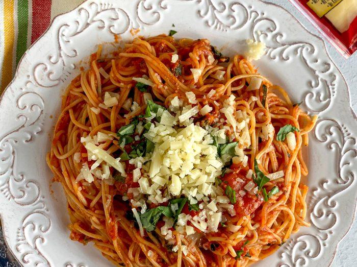 cappellini pomodoro with fresh Asiago