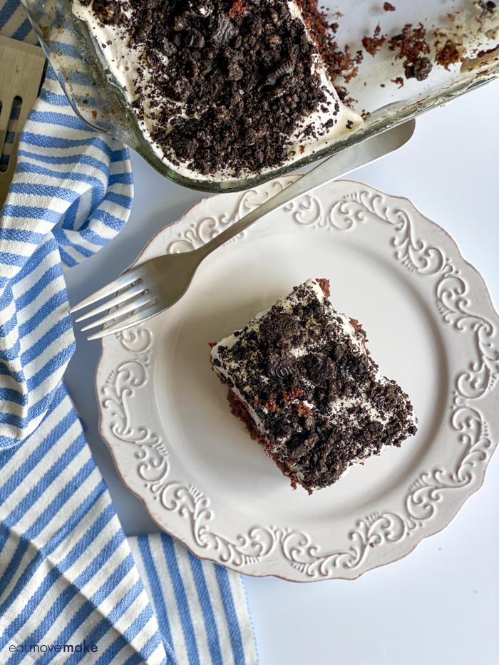 oreo poke cake on plate with napkin