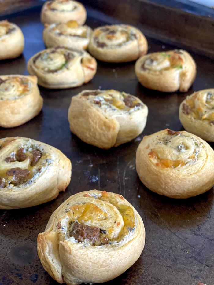 sausage crescent pinwheels on baking sheet