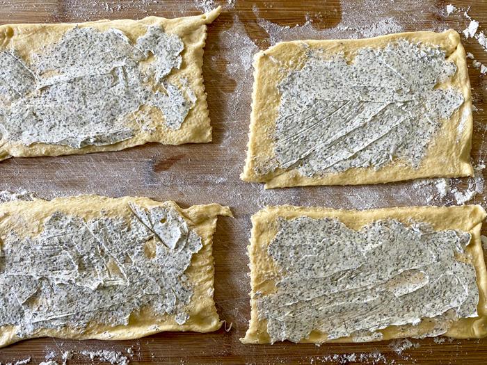 spread cream cheese on crescents