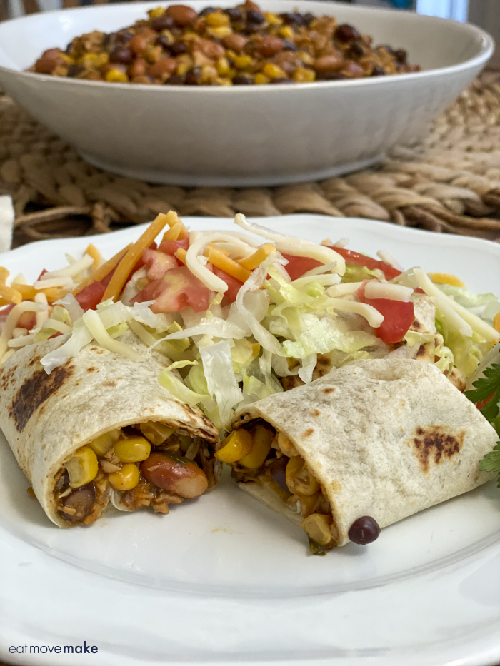 chicken and bean burrito on plate