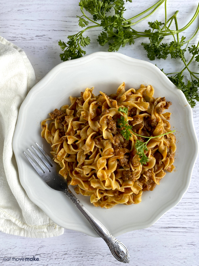 ground beef stroganoff on white plate with fork