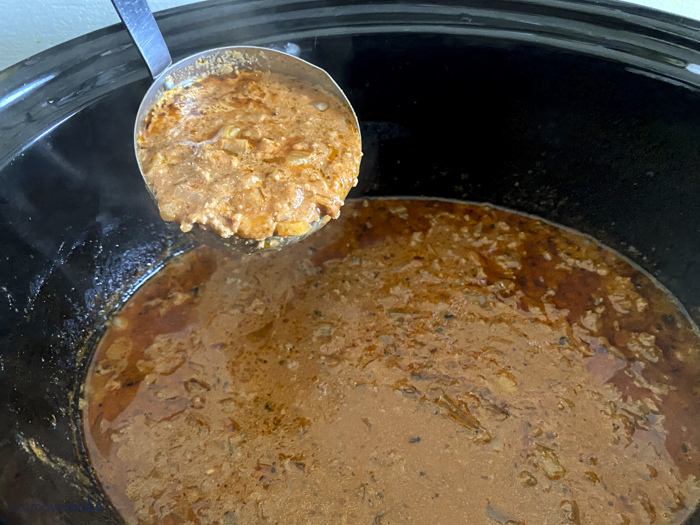 ladle of ground beef stroganoff sauce
