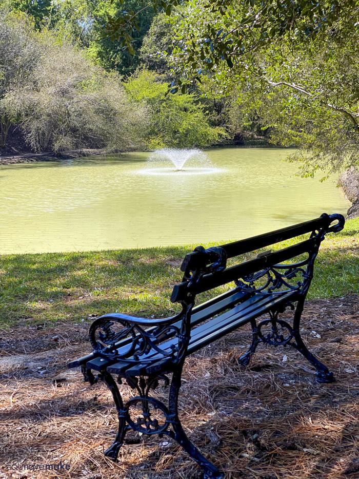 bench by pond at Hopeland Gardens Aiken SC