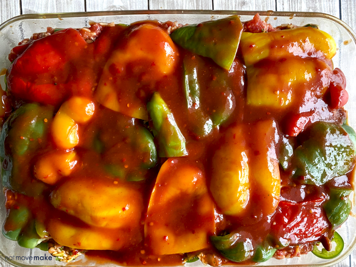 enchilada sauce on top of bell peppers