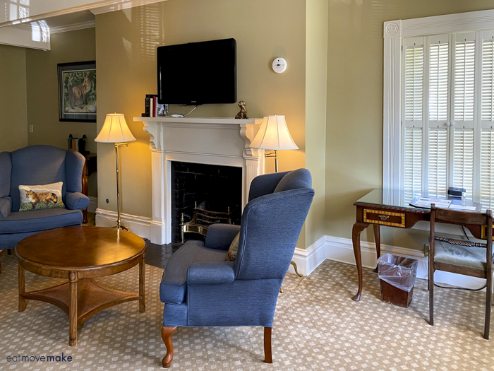 guest room sitting area by fireplace and desk