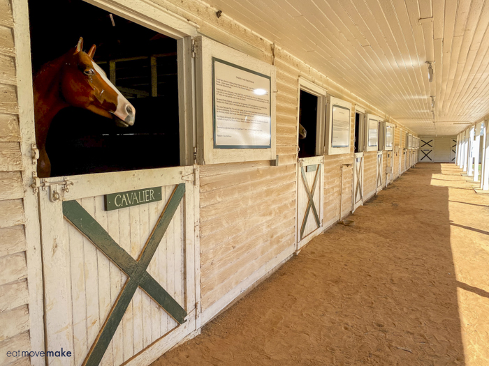 stables with horse statues
