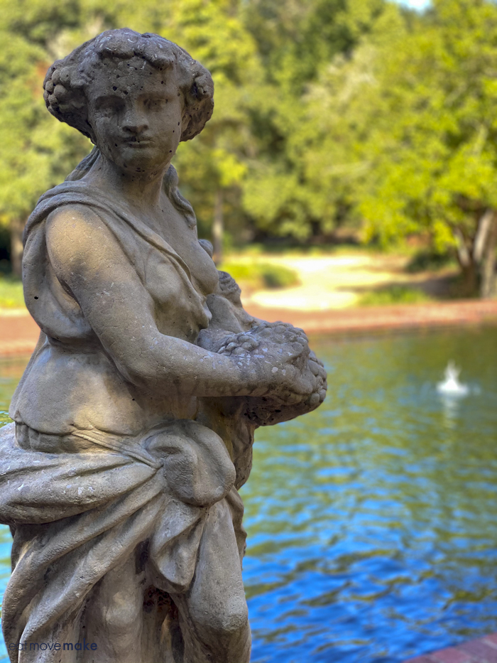 statue by reflecting pond