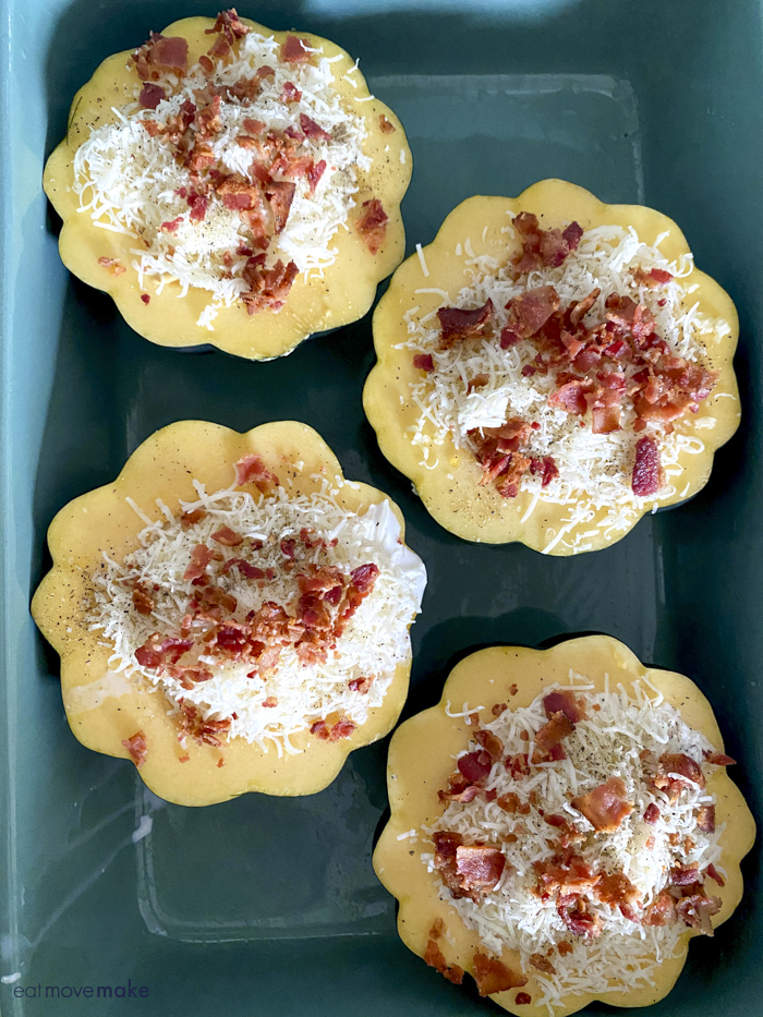bacon topping on cheese on acorn squash in casserole dish