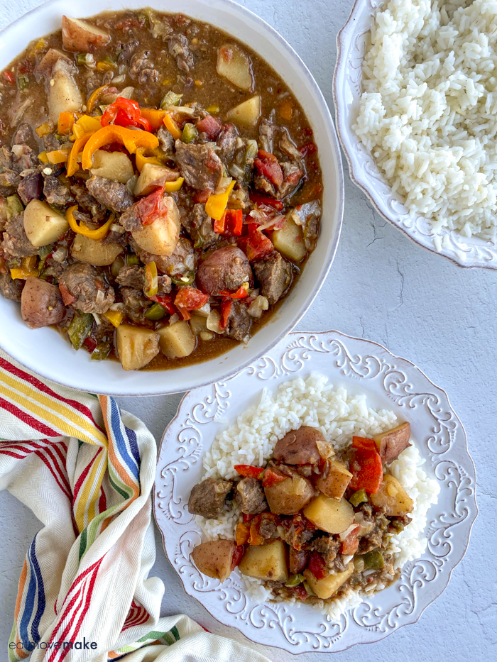 cajun beef stew on table with rice