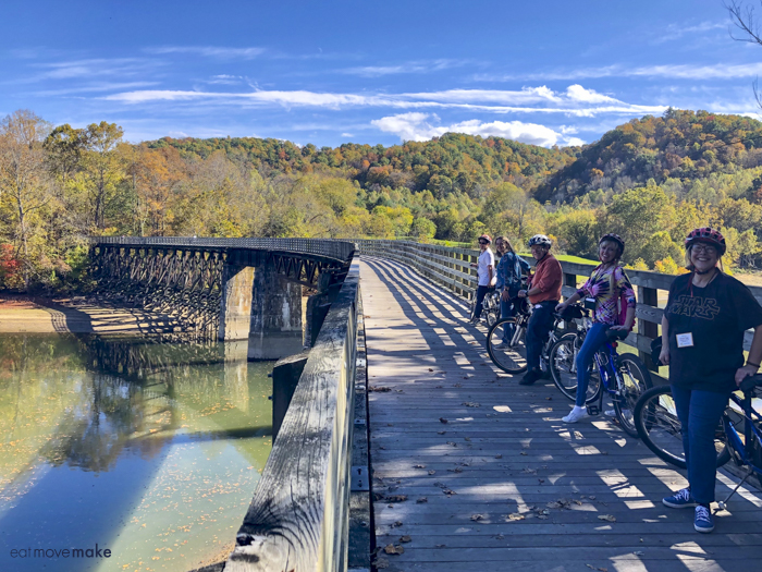 group of people on bikes on trestle