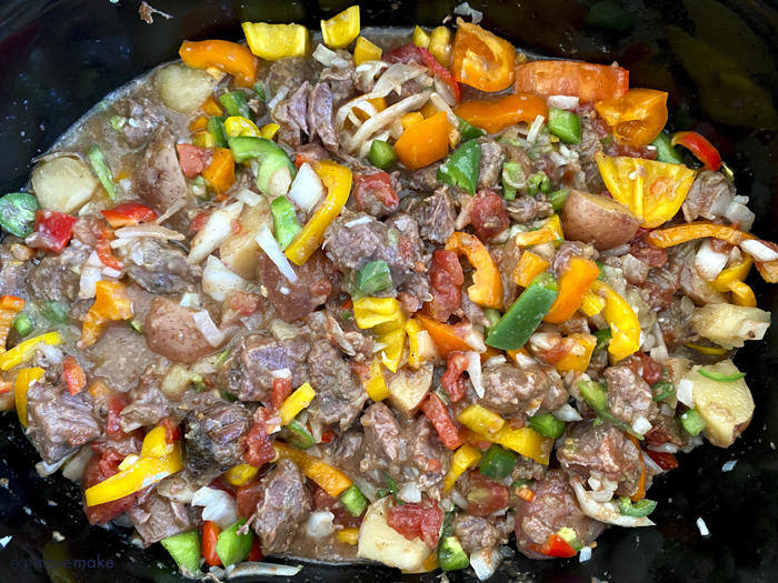 mixed in veggies with beef and potatoes in crockpot