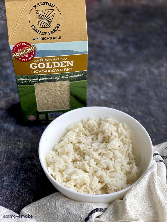 rice in bowl next to rice box