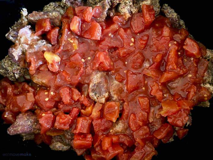 tomatoes on top of beef in crockpot