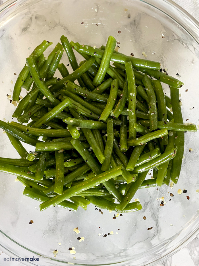 green beans tossed with seasoning