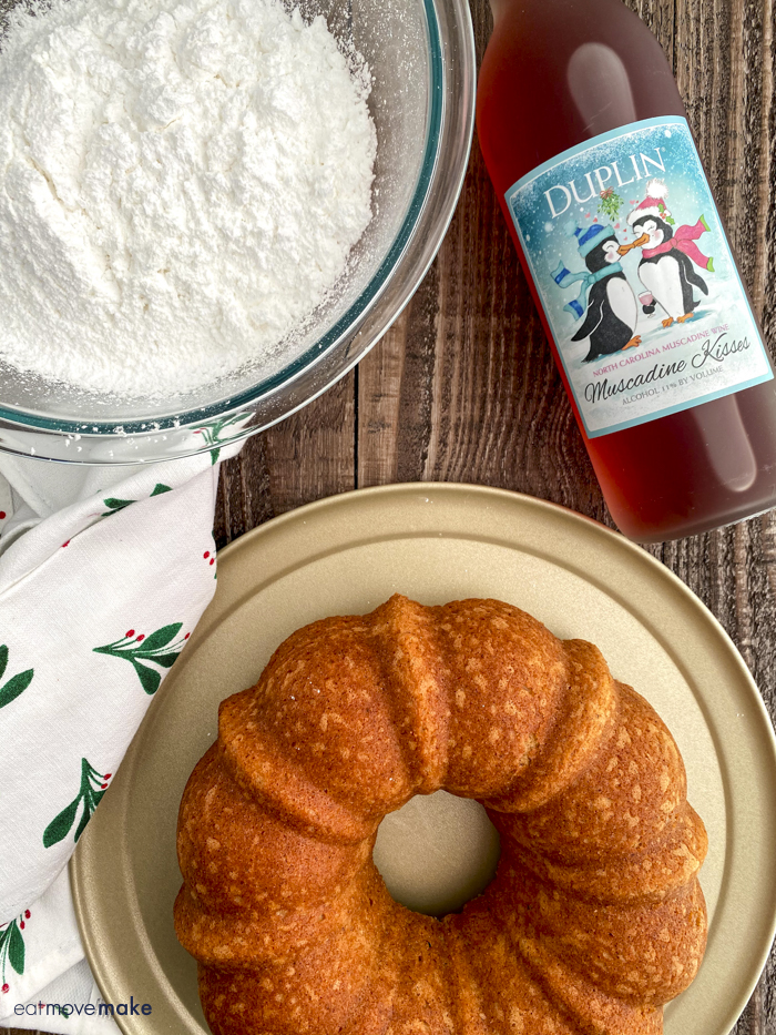 baked bundt cake with powdered sugar and wine