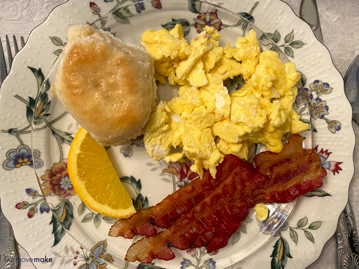bacon, eggs and biscuit on plate
