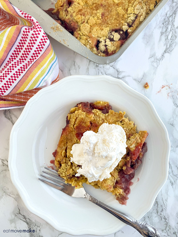 black cherry rhubarb dump cake on plate with fork