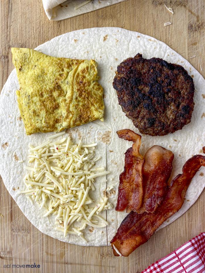 eggs, sausage, bacon and cheese on tortilla - Tiktok tortilla wrap hack