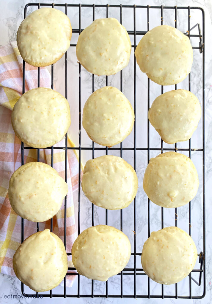frosted orange drop cookies on wire rack