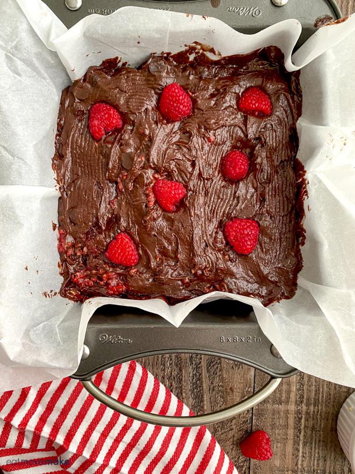 raspberry brownies batter in pan