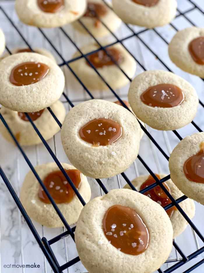 salted caramel thumbprint cookies on cooling rack