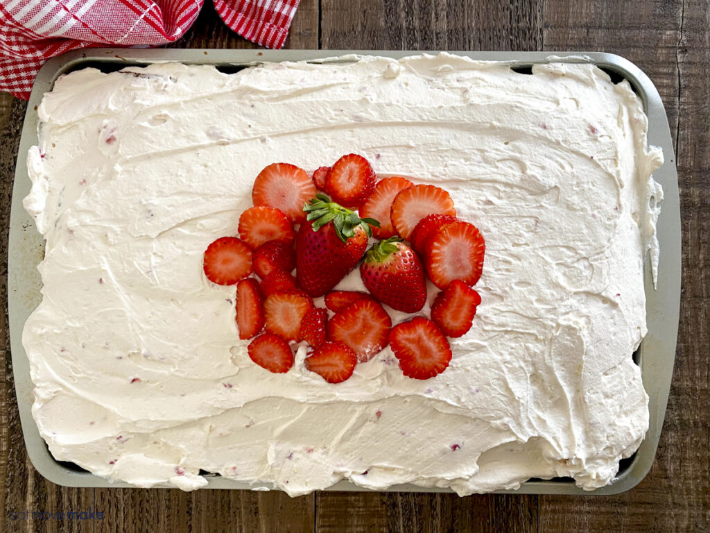 iced cake with strawberries on top